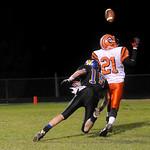 Western's Nick Kuzjak, 15, breaks up a pass to Orange's Lamar Gordon, 21. photo Ashley Twiggs