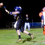 Western's Dom Losco, 25 reaches for a pass in the end zone, followed by Orange's Tyler Seal, 1. photo Ashley Twiggs