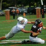 Oct. 3, 2009 - FUMA's Mitchell Starnes (7) takes down Woodberry's Grimes Creasy (58). photo Ashley Twiggs