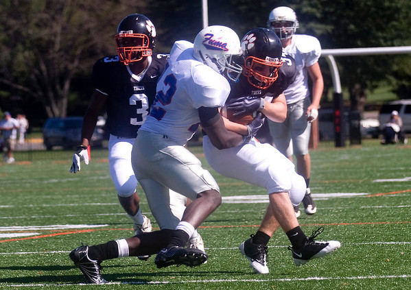 October 3, 2009 - Woodberry's Hatcher WIlliams (34) is brought down by FUMA's Akeem Garnett (12). photo Ashley Twiggs