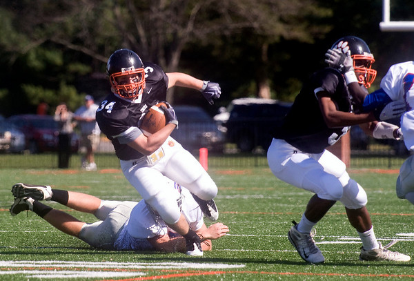 October 3, 2009 - Fork Union Military Academy's Mitchell Starnes (7), dives in an attempt to tackle Woodberry's Hatcher WIlliams (34). photo Ashley Twiggs