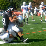 Oct. 3, 2009 - Woodberry's Ed Reynolds (29) gets tackled by FUMA's Mitchell Starnes (7) and Jorge Sanchez (23)