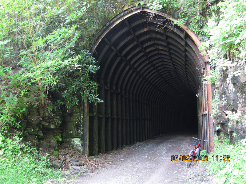 "Sharp's Tunnel is 511 feet long and is curved, so you can't see ""the light at the end of the tunnel"" until you're about half way through it.  Have you seen the movie The Hills Have Eyes?"