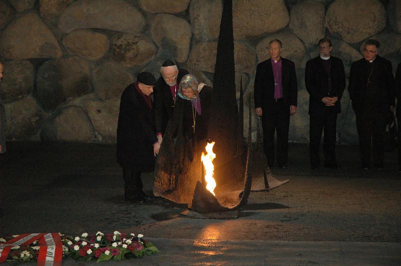 From left, ELCJHL Bishop Munib A. Younan, ELCA Presiding Bishop Mark Hanson and ELCIC National Bishop Susan Johnson light a symbolic eternal flame Jan. 8 at Yad Vashem, Jerusalem, a Holocaust memorial.
