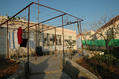 This is Sabri Ghrael Abu Sameer's house in Beddo, West Bank.  It is surrounded on three sides by the Israeli separation barrier, and Israeli settlements.