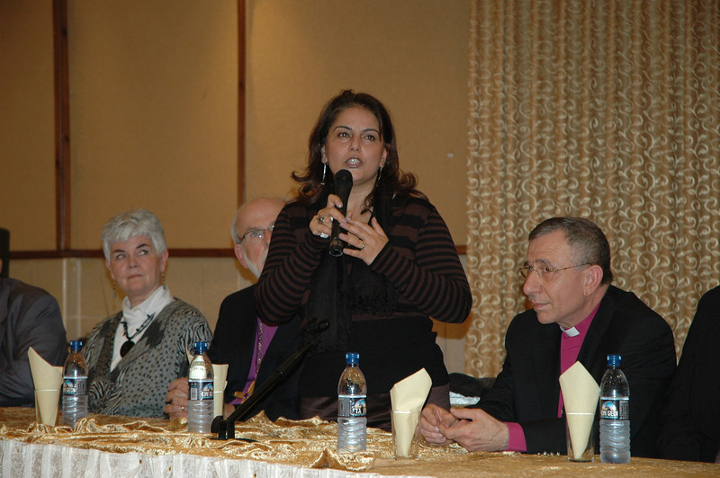 Dr. Khouloud Daipes, Minister of Tourism and Antiquities and Minister of Women's Affairs, Palestine, addresses the North American bishops at a reception in Bethlehem Jan. 11.  With her, from left, are Ione Hanson; ELCA Presiding Bishop Mark Hanson, and ELCJHL Bishop Munib Younan.