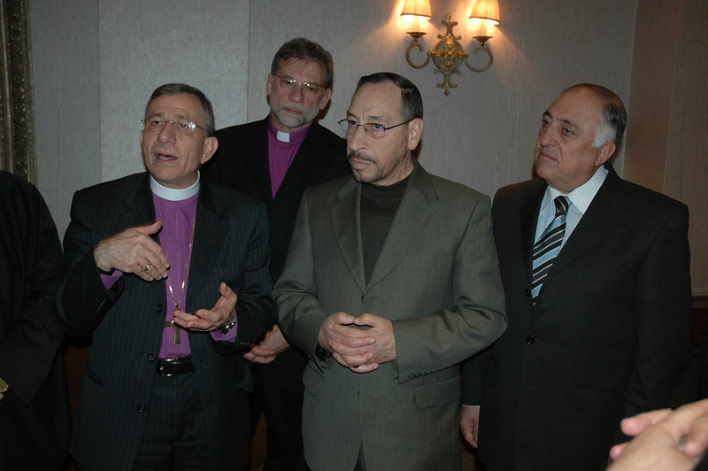 ELCJHL Bishop Munib Younan, left, makes a point during a meeting at the Jordanian Interfaith Coexistence Research Center in Amman Jan. 5.  Next to Younan is Jordan's Minister of Islamic Affairs, Abdal Fatah Salah and Sami Gammoh, Vice president of the Center.  At rear center is Bishop Bruce Burnside, ELCA South-Central Synod Wisconsin, Madison.