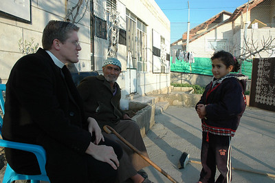 Bishop Michael Rinehart, left, ELCA Texas Louisiana Gulf Coast Synod, greets a young girl at Sabri Ghrael Abu Sameer's home in Beddo, West Bank.  The home is surrounded by the Israeli separation barrier.  With Rinehart is Sameer.