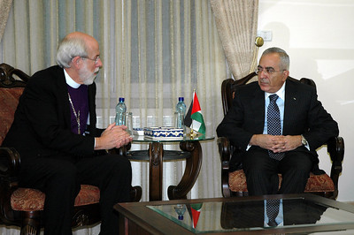ELCA Presiding Bishop Mark Hanson, left, speaks with Palestinian National Authority Prime Minister Salam Fayaad Jan. 13 in Ramallah.