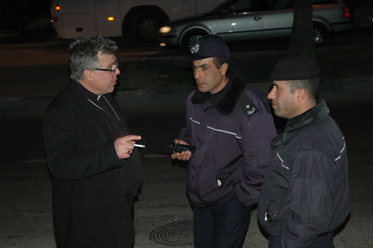 Bishop Michael Pryse, ELCIC Eastern Synod, talked with Palestinian police who watched over the North American Lutheran bishops during their Jan. 10 visit to Hebron.