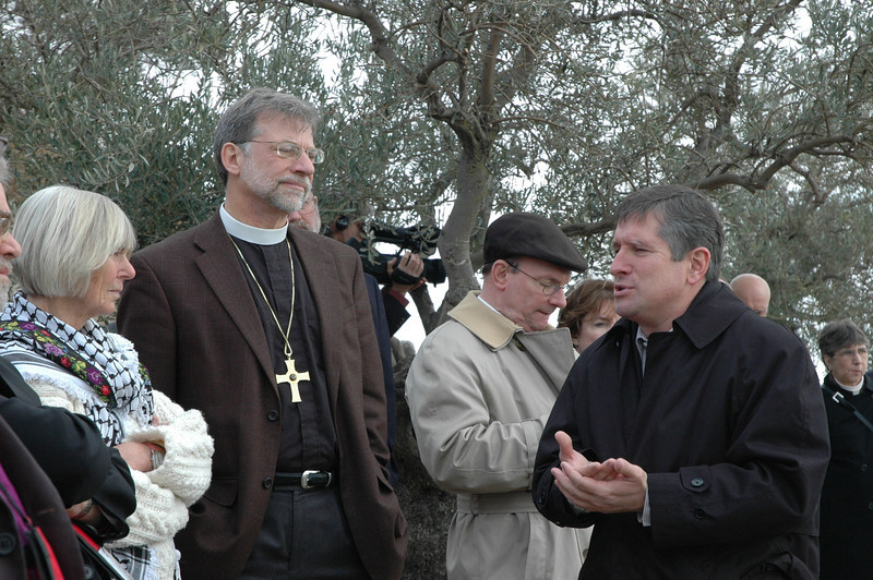 The Rev. Mark Brown, LWF Jerusalem representative, right, leads a tour of the Augusta Victoria Hospital grounds Jan. 9.  Listening are, from left, Cynthia Burnside and her husband, Bishop Bruce Burnside, ELCA South-Central Synod of Wisconsin, and Bishop Richard Graham, ELCA Metropolitan Washington, D.C., Synod.