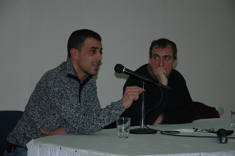 Mazen Faraj, left, a Palestinian refugee, and Rami Elhanan, an Israeli, discuss The Parent Circle, Israeli-Palestinian Bereaved Families for Peace, during a joint presentation to the bishops Jan. 7 in Jerusalem.