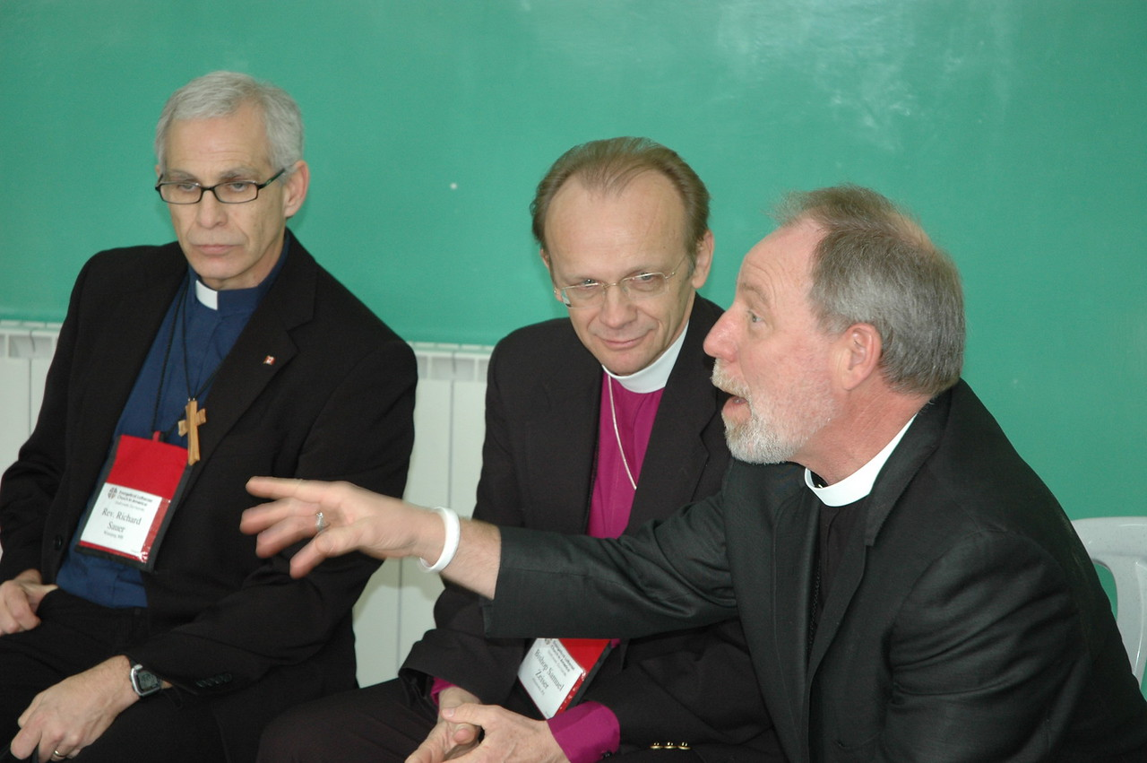 Bishop Michael Thomas Aitken, right, ELCA Northeastern Minnesota Synod, responds to students at Evangelical Lutheran School of Hope, Ramallah, Jan. 12.  With him, from left, are Pastor Richard Sauer, ELCIC, and Bishop Samuel Zeiser, ELCA Northeastern Pennsylvania Synod.