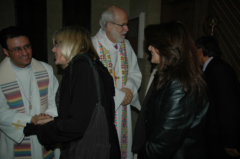The Rev. Samer Azar, left, pastor of Good Shepherd Evangelical Lutheran Church, Amman, and ELCA Presiding Bishop Mark Hanson, greet worshippers at the Amman congregation Jan. 4.