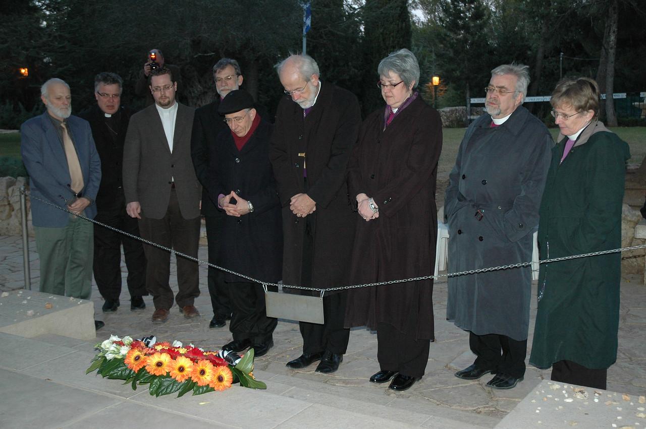Lutheran bishops pray Jan. 13 at the Jerusalem grave site of Yitzhak Rabin, former prime minister of Israel.