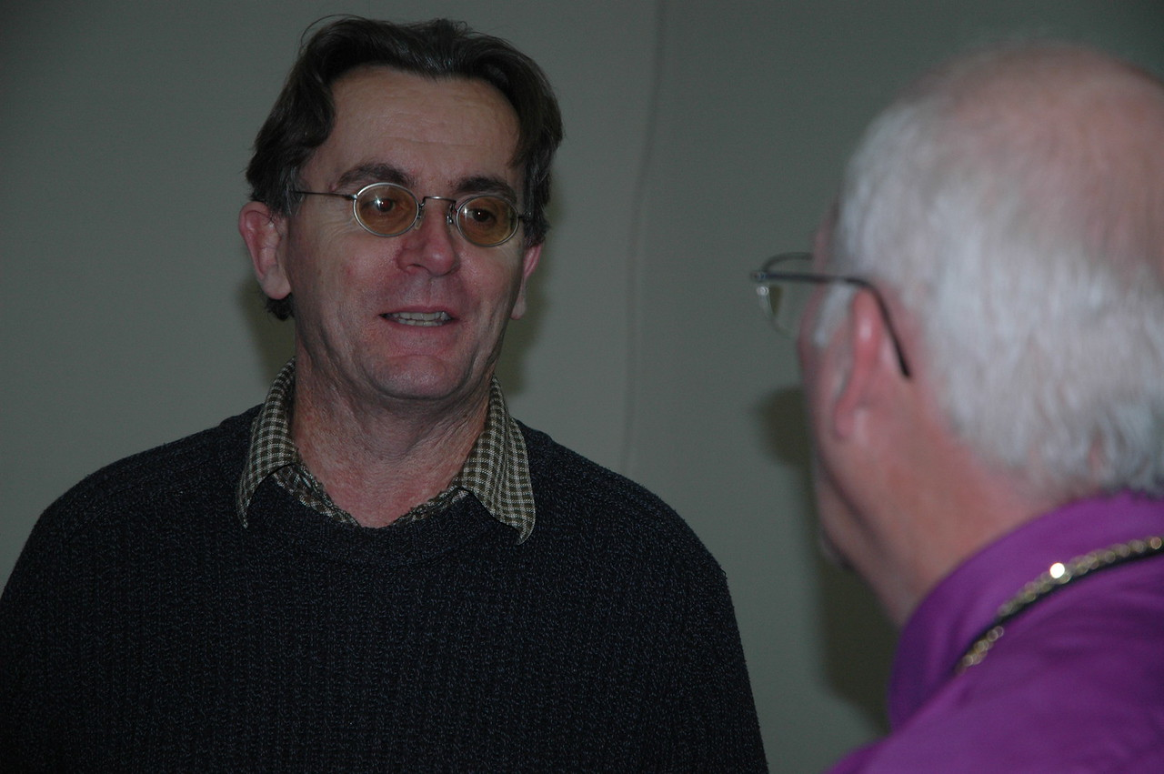 Ray Dolphin, UN Office for Coordination of Humanitarian Affairs, speaks with Bishop Gary Wollersheim, ELCA Northern Illinois Synod, following a presentation to the bishops Jan. 7.
