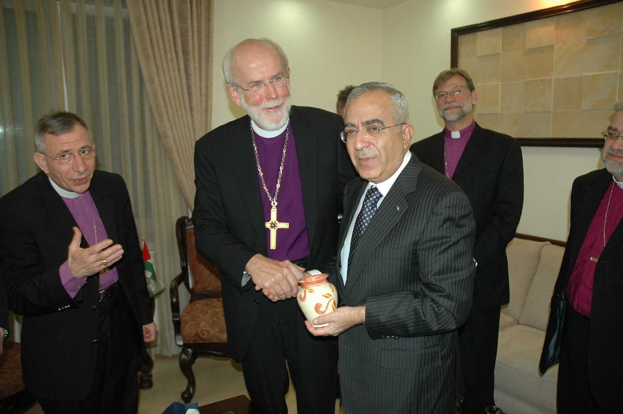 ELCA Presiding Bishop Mark Hanson, center, presents a pottery gift to Palestinian National Authority Prime Minister Salam Fayaad Jan. 13 in Ramallah.