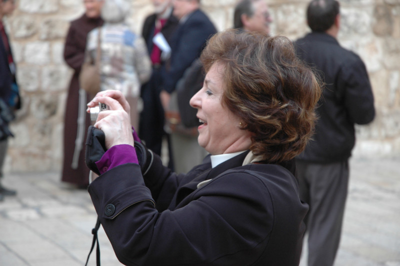 Bishop Claire Burkat, ELCA Southeastern Pennsylvania Synod, snaps a photograph Jan. 9 outside the Church of the Holy Sepulchre, Jersualem.