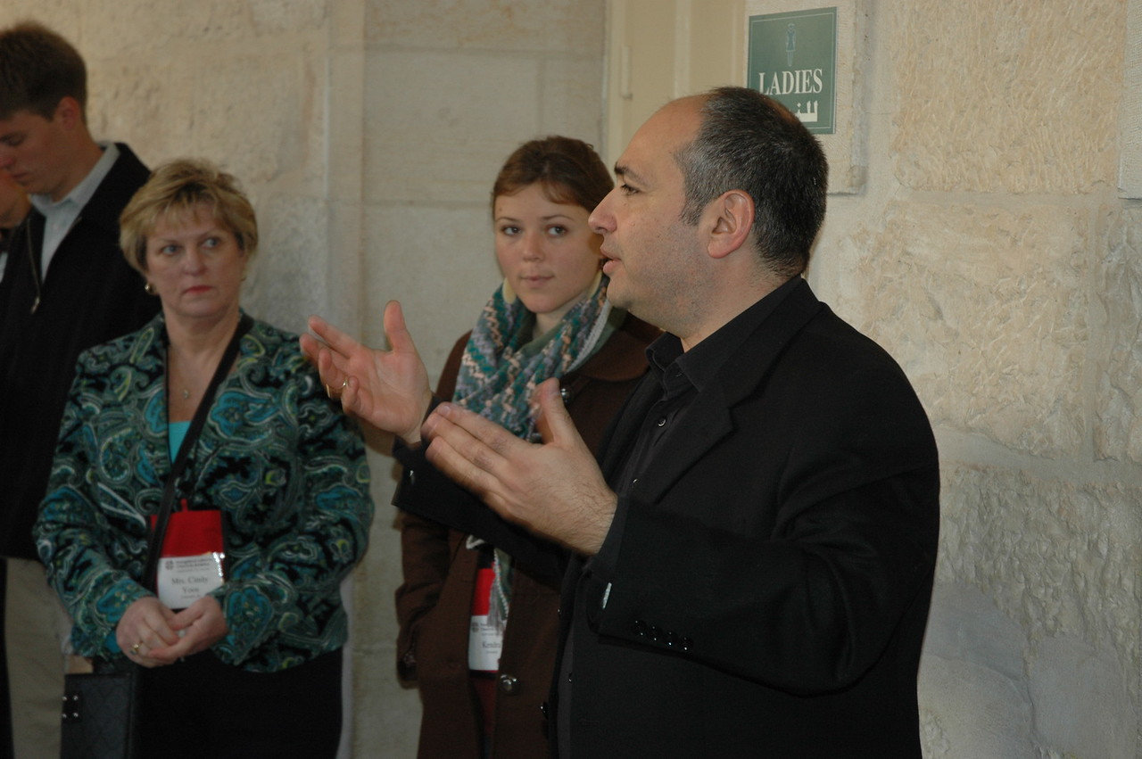 Dr. Tawfiq Nasser, director of the LWF's Augusta Victoria Hospital, East Jerusalem, leads a tour group Jan. 9, during the bishops' visit to the hospital.