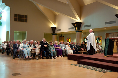 Fr. Peter blesses the couples and offers the communities congratulations.  Everyone broke into applause.