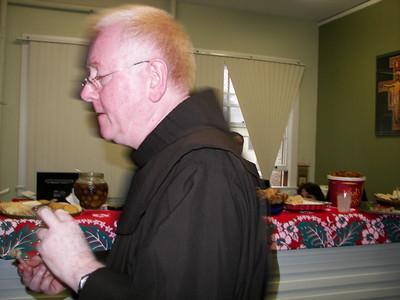 Father Adrian waits patiently for his piece of flan.