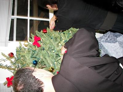 Fr. Chuck decorates the Christmas tree in the parish lobby.