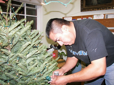 Paciano, one of our hard working maintenance staff,  works on the Christmas tree lights.