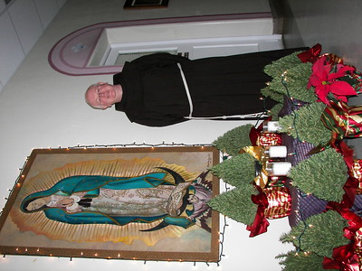 Fr. Adrian beside Our Lady of Guadalupe.