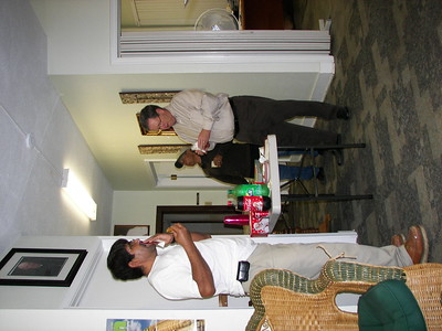 Fidel and Julio, members of our Maintenence Staf, share some cookies and homemade eggnog with Allen.