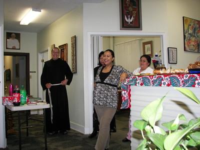 Bonnie, the Religious Education Secretary, Shirley the Parish Secretary and Elena the Spanish RE coordinator look on.