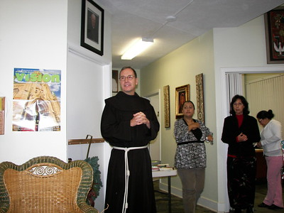 Fr. Chuck leads the staff in a prayer before we share a meal together.