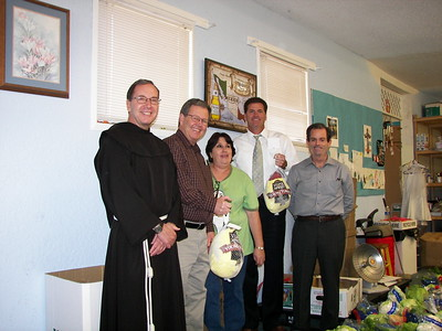 Father Chuck, Business Manager Allen Hartman, Social Concerns Director Carmen Parra and two special guests...