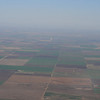North Central Oklahoma landscape.  Very flat.  The white spot in the distance is a grain elevator.