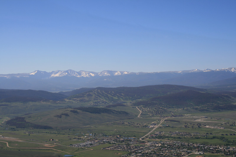 Departing Granby, looking Southeast over the town.  Airport is lower left.  The airport is surrounded by snow capped mountain peaks, requiring a good climbing airplane.
