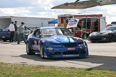 Paddock, Pits & Cars