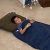 Parker in sleeping bag in apartment