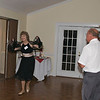 Becky Nixon Winslow doing some steps while Lloyd Ray Morgan looks on