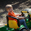 Aidan loves tractoring..