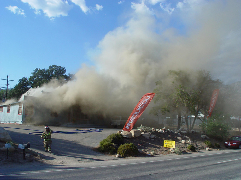 Smoke pours from the Kern Valley Bionicon Demo Center in Wofford Heights Friday afternoon.