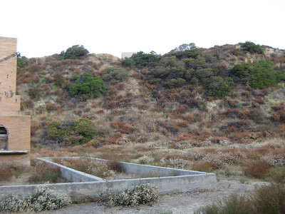 Old foundation with water tank in background