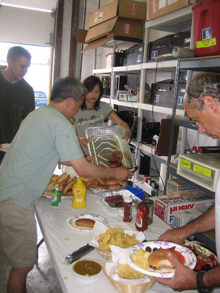 Leonard Lee, Yvette Ju, Tom, and Steven break for burgers, having worked up a hearty appetite pushing boxes in circles all morning.