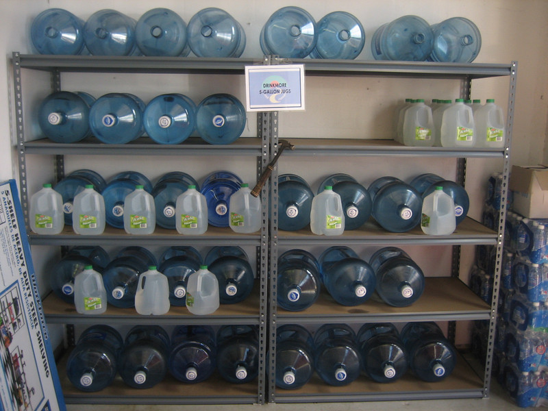 The plan to organize the water bottles actually comes to fruition!  I'm amazed.  (Do you realize each one of those shelving units is holding 900 lbs!)  Sadly, no picture exists of George Tarrico and Lyman pretesting the units with their own body weight.