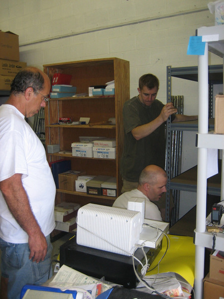 Danny Talmage and Steven Zuraf install new shelves.  Tom Fillipone does the much harder work of supervising.