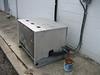Neighbor's free-standing heat pump.