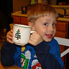 Aidan loves his Christmas tree cup.