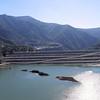 San Gabriel Reservoir - Dam material cut from hill to left