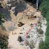 06/17 Overview.  Moving dirt to allow repositioning excavator.  The rock wall is as high as they are going to build it.