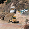 8/6 dumping fill on the ramp.  The dozer in the middle will spread it and pack it after they add the next layer of mesh.