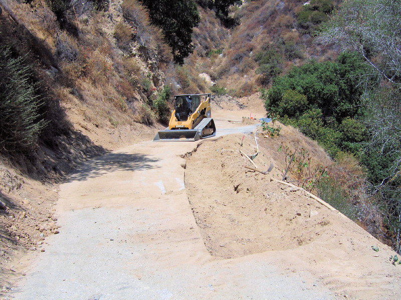 8/12 They are preparing for paved section for repair.