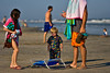 This little guy can't believe that summer is over.  In the background, another dad is about to deliver the bad news.